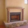 Home by TC Builders Custom carved mantel.